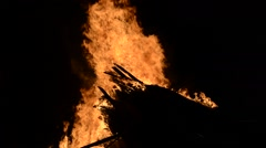 Massive flames on bonfire in cold winter night in the arctic circle Stock Footage