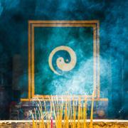 Burning incense with Yin Yang symbol Stock Photos