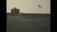 Vintage 16mm film, 1934, New Jersey, baseball game flag, players walk to center Stock Footage