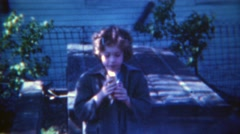 1953: Skeptical girl eating hotdog in the shadows of society.  PITTSBURG - stock footage