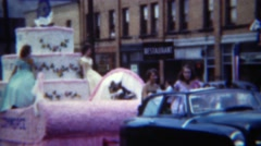 1951: Chamber of Commerce parade float women long dresses. ERIE, PENNSYLVANNIA Stock Footage
