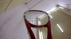 Playing squash. Racket and ball on a court. - stock footage
