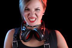 Expressive girl in headphones Stock Photos