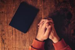 Hands of Christian woman praying Stock Photos