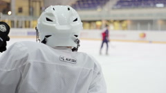 Hockey player looks on the ice and waiting for their turn going out on the ice Stock Footage