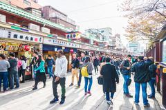 TOKYO - November 24 2015 : Many People around shopping street in Asakusa area Stock Photos