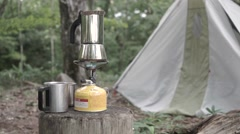 Coffee pot on a gas burner at a camping site, Yamanashi Prefecture, Japan - stock footage