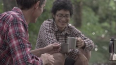 Slow motion footage of friend enjoying cofee at a camp site, Yamanashi Stock Footage