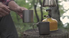 Slow motion footage of Caucasian man having coffee at a camp site, Yamanashi Stock Footage