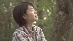 Slow motion footage of Japanese woman enjoying nature at a camp site, Yamanashi - stock footage