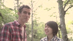 Slow motion footage of friends laughing at camera at a camp site, Yamanashi Stock Footage