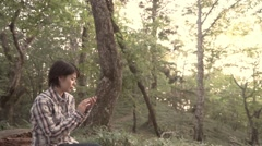 Slow motion footage of Japanese woman with smartphone at a camp site, Yamanashi Stock Footage