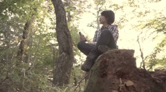 Slow motion footage of Japanese woman enjoying a beer at a camp site, Yamanashi - stock footage