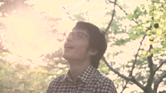 Young Japanese man portrait at a camp site, Yamanashi Prefecture - stock footage