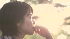 Slow motion footage of Japanese woman enjoying nature at a camp site, Yamanashi Stock Footage