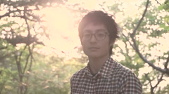 Young Japanese man portrait at a camp site, Yamanashi Prefecture Stock Footage