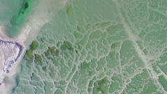 Aerial Israel. Top view on green, blue, water of dead sea with salt minerals Stock Footage