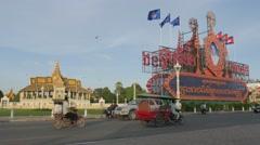 Traffic passes Royal Palace park,Phnom Penh,Cambodia Stock Footage