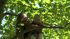 Happy mother woman play with infant baby daughter under tulip tree. 4K Stock Footage