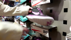 Woman picking one of exposition sport shoe Stock Footage