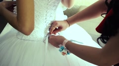 Stylish bride wears a white dress lace bridesmaid help Stock Footage