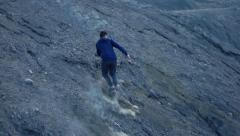 Young boy running up through volcano, super slow motion 240fps Stock Footage