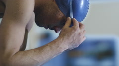 Professional Concentrated Male Swimmer in Goggles on Starting Block Before Jump - stock footage