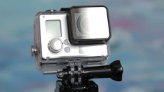 Action camera underwater box rotates around the axis Stock Footage