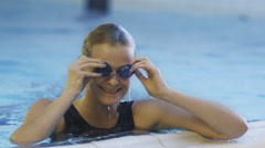 Happy Professional Female Swimmer in Goggles Getting out the Water - stock footage