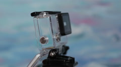Action camera is inserted into the underwater housing Stock Footage