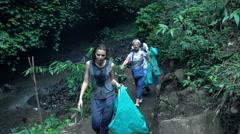 People trekking in jungle, super slow motion 120fps Stock Footage