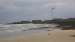 Windmill by the ocean of Jeju island in South Korea Stock Footage