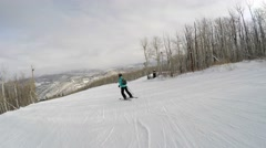 A woman skiing down mountain resort hill shot with gimbal - stock footage
