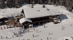 Aerial shot of a Ski resort in the French alps with alpine tree's in foreground Stock Footage