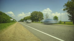 Road timelapse with cars and clouds - stock footage