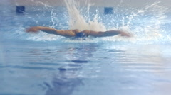 Shot from Front Side of Professional Swimmer Performing Butterfly Stroke Stock Footage