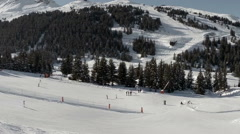 Aerial shot of people skiing in a french ski resort in the Alps Stock Footage