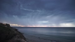 Rain clouds atop the ocean Stock Footage