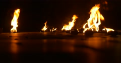 Stock Video Footage of Fire Torches Are Lying on a Ground And Burning Artists Left the Torches after