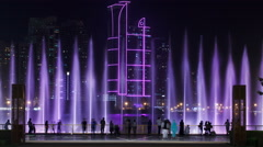 Evening Musical fountain show. Singing fountains in Sharjah timelapse, UAE Stock Footage