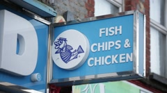Fish and chips sign on the shop in England, Europe Stock Footage