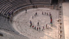 Children playing in amphitheater in Bosra Stock Footage