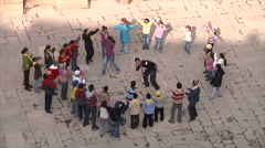 Children in amphitheater in Bosra - stock footage