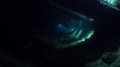 Dark corridor inside the shipwreck with magical sun rays - Umbria, Sudan Stock Footage