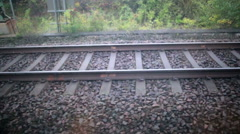 Wagon wheel effect train tracks optical illusion perception backwards Stock Footage