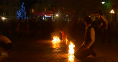 Stock Video Footage of Artists Men And Women Are Dancing With Fire Torches by Turn Troup of Artists
