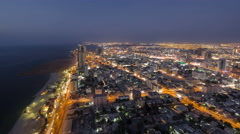 Cityscape of Ajman from rooftop day to night timelapse. Ajman is the capital of - stock footage