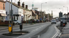 Typical street in England: traffic and shops, different temples, England, EU Stock Footage