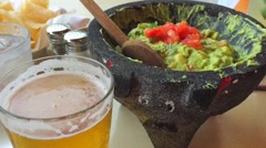 Mexican Guacamole, Beer and Tortilla Chips - stock footage
