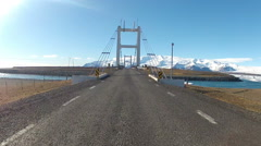 One way steel bridge river Jokulsarlon Vatnajokull glacier oncoming traffic  - stock footage